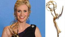 Jane Lynch appears in a promo photo for the 2011 Primetime Emmy Awards. / A Primetime Emmy Award. - Provided courtesy of emmys.com / www.facebook.com/primetimeemmys