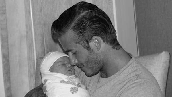 David Beckham holding newborn daughter Harper Seven in a Twitter photo posted by Victoria Beckham. - Provided courtesy of Facebook.com/Beckham