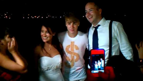 Justin Bieber poses with Rob McCool and his new bride Jeanine at their Malibu wedding that he crashed on July 16, 2011. - Provided courtesy of OTRC / youtube.com/user/katimage