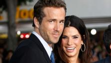 Cast member Ryan Reynolds, left, and Sandra Bullock pose together at the premiere of The Change-Up in Los Angeles, Monday, Aug. 1, 2011. - Provided courtesy of AP / Matt Sayles