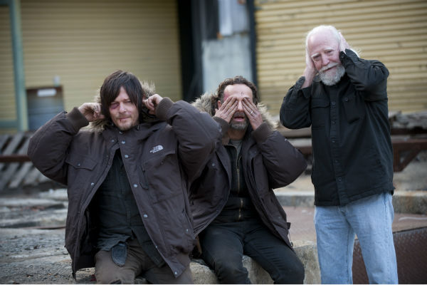 Norman Reedus &#40;Daryl Dixon&#41;, Andrew Lincoln &#40;Rick Grimes&#41; and Scott Wilson &#40;Hershel Greene&#41; make silly gestures on the set of AMC&#39;s &#39;The Walking Dead&#39; season 4 finale, which aired on March 30, 2014. <span class=meta>(Gene Page &#47; AMC)</span>