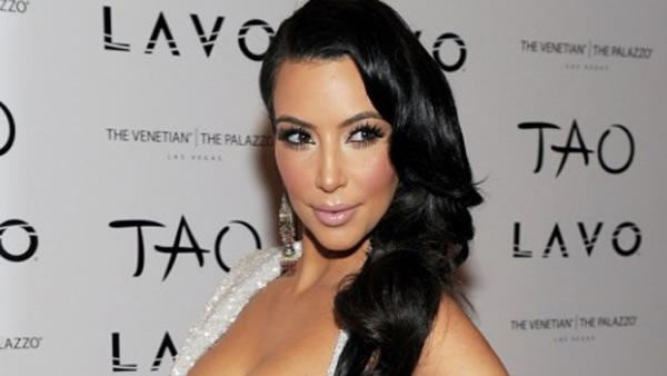 Kim Kardashian poses at Tao nighclub at the Venetian hotel in Las Vegas ahead of he