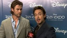 Robert Downey Jr. and Chris Hemsworth talk to OnTheRedCarpet.com about the upcoming Avengers film at D23. - Provided courtesy of OTRC