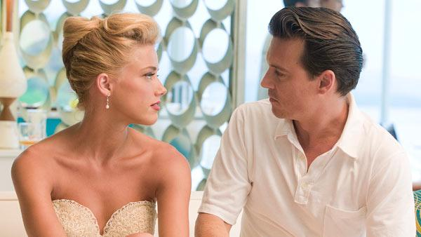 Johnny Depp and Amber Heard appear in a still from the 2011 film, The Rum Diary. - Provided courtesy of FilmDistrict / Peter Mountain