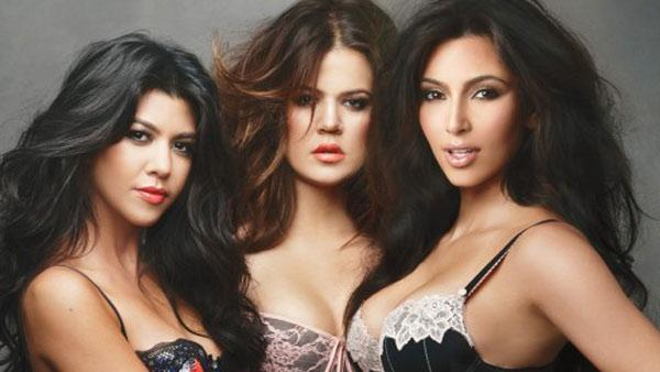 Kourteney, Khloe and Kim Kardashian appear in a photo posted on Kims official website on September 2, 2011. - Provided courtesy of OTRC / KimKardashian.Celebuzz.com