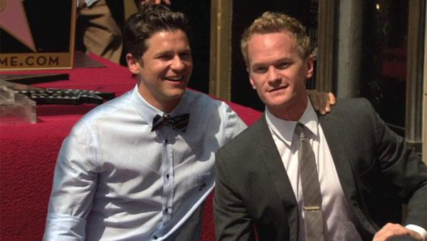 Neil Patrick Harris poses with his life partner David Burtka on his star on the Walk of Fame. The actor received the honor on Sept. 15, 2011.