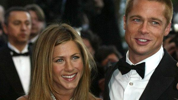 Brad Pitt, right, and his wife Jennifer Aniston arrive for the screening of the film Troy, directed by German director Wolfang Petersen, at the 57th Film Festival in Cannes, France, Thursday, May 13, 2004. - Provided courtesy of AP / Lionel Cironneau