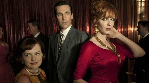 Elisabeth Moss, Jon Hamm and Christina Hendricks appear in a promotional photo for the AMC series Mad Men. - Provided courtesy of AMC