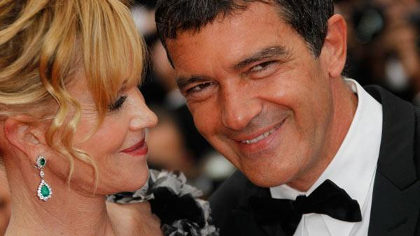 Spanish Actor Antonio Banderas, right, and his wife Melanie Griffith arrive for the screening of Midnight in Paris and the opening ceremony, at the 64th international film festival, in Cannes, southern France. - Provided courtesy of AP / Joel Ryan