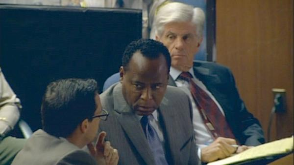 Dr. Conrad Murray speaks to one of his attorneys during opening statements on Sept. 27, 2011. Murray, accused of killing Michael Jackson, has pleaded not guilty to involuntary manslaughter. - Provided courtesy of OTRC