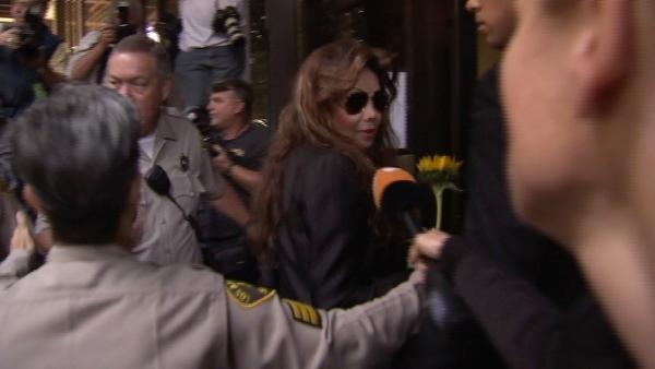 Holding a sunflower given her by a fan, Michael Jackson's sister Latoya Jackson arrives at the involuntary manslaughter trial for Dr. Conrad Murray on Tuesday, Sept. 27, 2011.