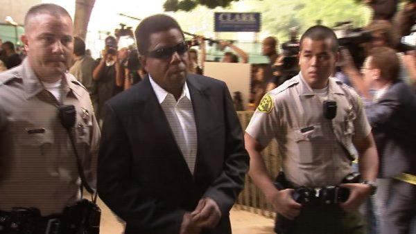 Michael Jackson's brother Tito Jackson, center, arrives to court for the trial of Conrad Murray on Tuesday, Sept. 27, 2011.