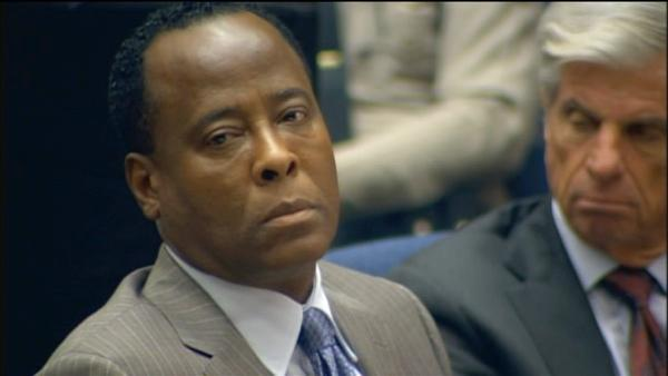 Dr. Conrad Murray listens as Deputy District Attorney David Walgren delivers opening statements on Sept. 27, 2011.