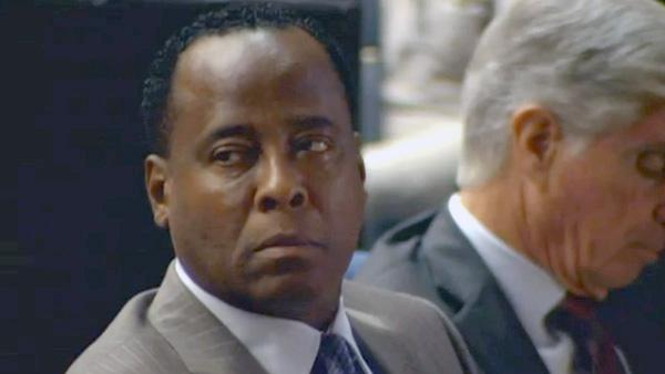 Dr. Conrad Murray listens as Deputy District Attorney David Walgren delivers opening statements in his involuntary manslaughter trial on Tuesday, Sept. 27, 2011 in Los Angeles.