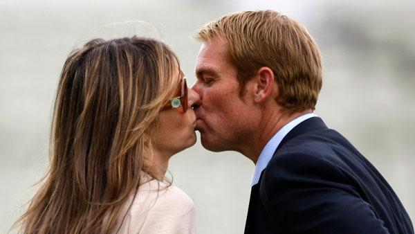Former cricketer Shane Warne shares a kiss with girlfriend Elizabeth Hurley after the fourth day of the third test match at the Edgbaston Cricket Ground, Birmingham, England, Saturday, Aug. 13, 2011. - Provided courtesy of AP Photo/Tim Hales
