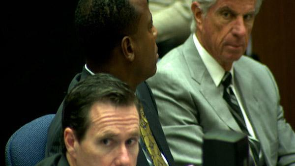 Oct. 5, 2011: Conrad Murray appears between his attorneys, Ed Chernoff (bottom) and Michael Flanagan at his involuntary manslaughter trial.
