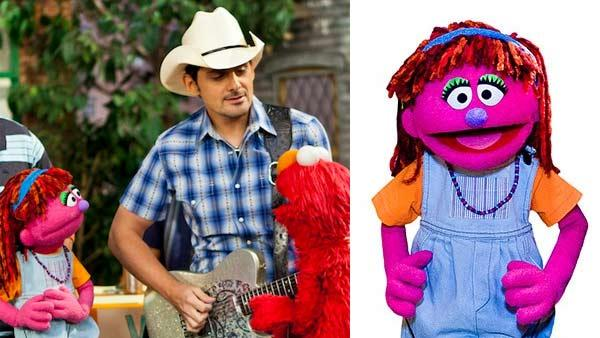 Sesame Street muppet Lily and Elmo with Brad Paisley. - Provided courtesy of Sesame Workshop / PBS