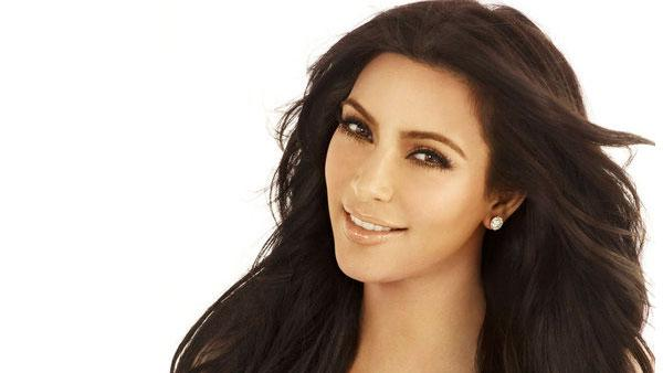 Kim Kardashian appears in a promotional image for Keeping Up With The Kardashians in 2011. - Provided courtesy of E!
