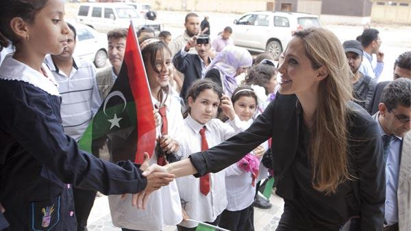 n this photo released by Jason Tanner through the Press Association , actress and U.N. goodwill ambassador Angelina Jolie meets locals in Misrata, Libya Tuesday Oct. 11, 2011. - Provided courtesy of AP / Jason Tanner/ ho