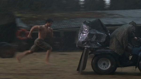 Taylor Lautner runs shirtless in the rain as he shoots a scene for the movie 'The Twilight Saga: Breaking Dawn' in 2011.