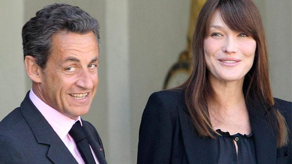 France's President Nicolas Sarkozy and his wife Carla Bruni-Sarkozy appear at the Elysee Palace in Paris on Friday, May 13, 2011.