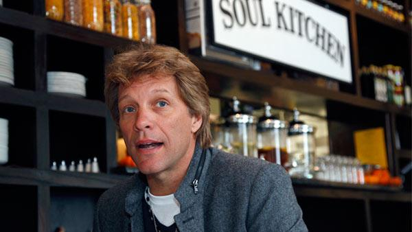 Rock star Jon Bon Jovi sits in the Soul Kitchen restaurant in Red Bank, N.J., Wednesday, Oct. 19, 2011, during the opening of the restaurant which is designed to help the hungry without the stigma of a soup kitchen. Diners pay whatever theyre able to. - Provided courtesy of AP / Mel Evans