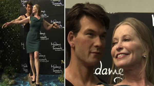 Patrick Swayze's widow poses with wax figure