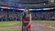 Zooey Deschanel sings at Game 4 of the 2011 World Series in Arlington, Texas on Oct. 23, 2011. - Provided courtesy of FOX / MLB