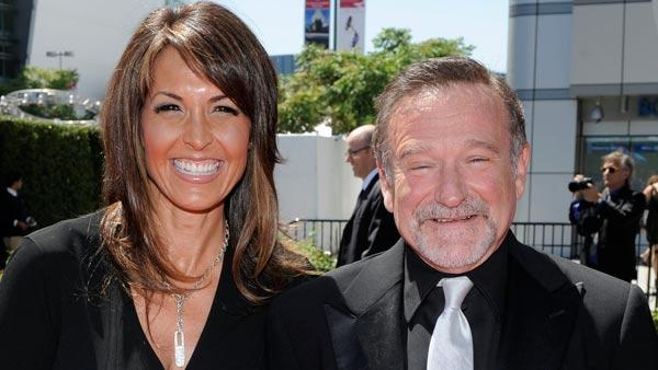 Robin Williams, right, and Susan Schneider arrive at the Creative Arts Emmy Awards on Saturday, Aug. 21, 2010 in Los Angeles.