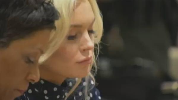 Lindsay Lohan reacts as a judge sentenced her to 30 days in jail for violating her probation. She apppeared at a hearing at a Los Angeles court on Nov. 2, 2011.