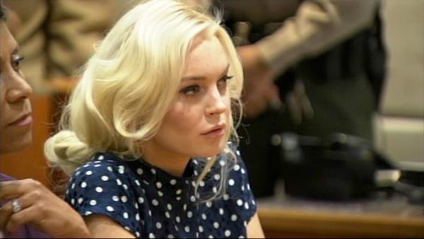 Lindsay Lohan reacts as a judge sentenced her to 30 days in jail for violating her probation. She apppeared at a hearing at a Los Angeles court on Nov. 2, 2011. - Provided courtesy of OTRC