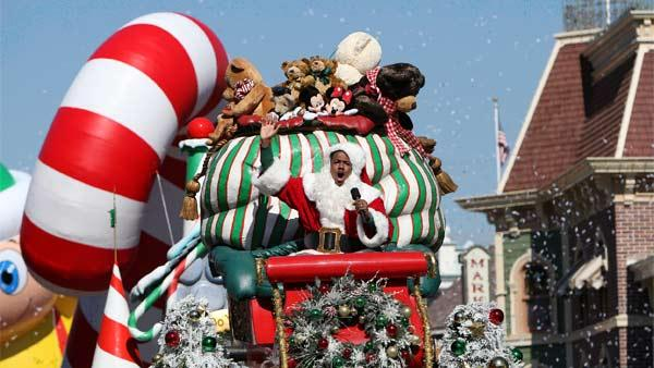 Nick Cannon is joined by Disney Channel characters Phineas and Ferb during the taping of the 2011 Disney Parks Christmas Day Parade at Disneyland in Anaheim, California, on Nov. 5, 2011.
