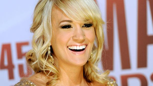 Carrie Underwood arrives at the 45th Annual CMA Awards in Nashville on Wednesday, Nov. 9, 2011. - Provided courtesy of AP / Evan Agostini