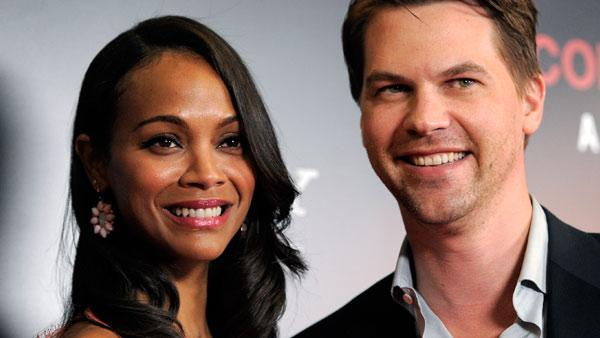 Zoe Saldana, left, star of the film 'Colombiana,' poses with her fiance' Keith Britton at a special screening of the film, Wednesday, Aug. 24, 2011, in West Hollywood, Calif.