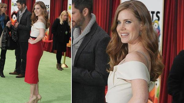 Amy Adams arrives at the premiere of The Muppets at El Capitan Theater, Saturday, Nov. 12, 2011, in Los Angeles. The Muppets opens in theaters Nov. 23, 2011. - Provided courtesy of AP / AP Photo / Katy Winn