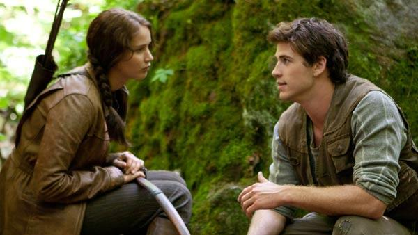 Jennifer Lawrence and Liam Hemsworth appears in a scene from The Hunger Games. - Provided courtesy of Lionsgate