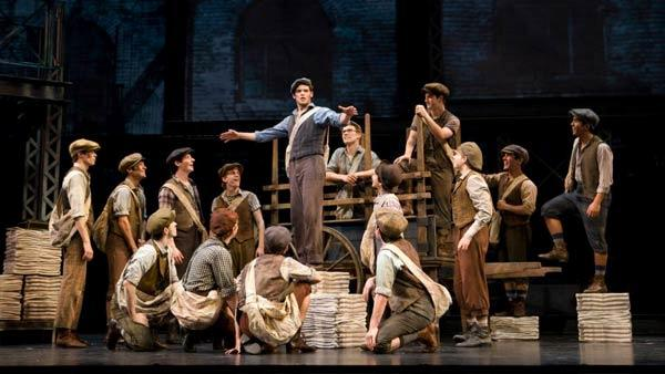 The cast of the Newsies musical on stage in a promotional photo from the plays official facebook page. - Provided courtesy of Facebook.com/Newsies