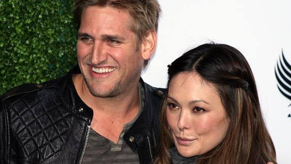 Lindsay Price and Curtis Stone appear in a photo from the Black Eyes Peas Benefit Concert at the Music Box in 2009.