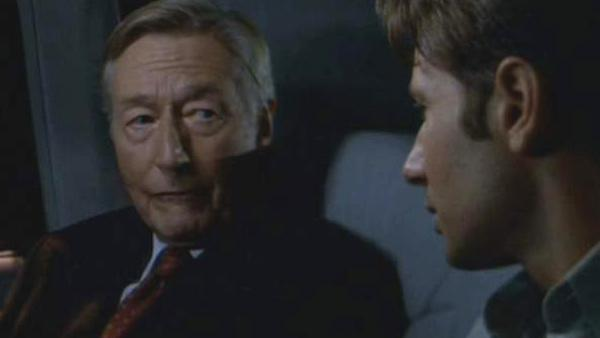 John Neville appears alongside David Duchovny in a scene from the 1998 film 'The X-Files.'