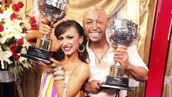 'All My Children' actor and Iraq War veteran J.R. Martinez and his partner Karina Smirnoff hold up their Mirrorball Trophies after winning season 13 of 'Dancing With The Stars' on Tuesday, Nov. 22, 2011.