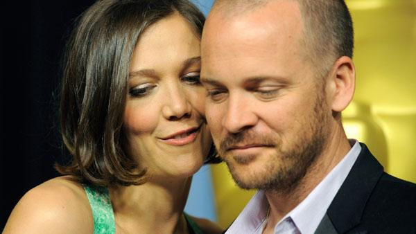 Maggie Gyllenhaal poses with her husband, actor Peter Sarsgaard, at the Academy Awards Nominees Luncheon in Beverly Hills, Calif., Monday, Feb. 15, 2010.