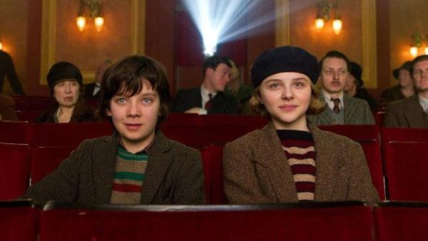 Chloe Grace Moretz and Asa Butterfield appear in a scene from the 2011 film Hugo. - Provided courtesy of GK Films