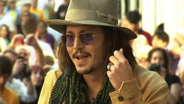 Johnny Depp gives a speech honoring Penelope Cruz before she receives a star on the Hollywood Walk of Fame on April 1, 2011.