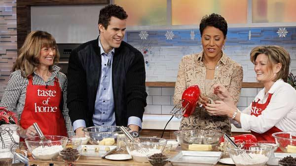 NBA star Kris Humphries and his mom Debra Humphries visit ABCs Good Morning America on Dec. 9, 2011, following Kim Kardashians divorce filing, and bake holiday cookies with Taste of Home editor-in-chief Catherine Cassidy - Provided courtesy of ABC / Lou Rocco