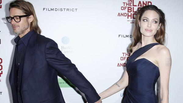 Brad Pitt, left, and Angelina Jolie, writer and director of the film In the Land of Blood and Honey, pose at the premiere in Los Angeles on Thursday, Dec. 8, 2011. - Provided courtesy of AP / Danny Moloshok
