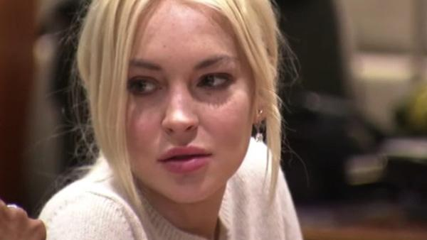 Lindsay Lohan appears at a Los Angeles court on Dec. 14, 2011 for her first progress report under new requirements of her probation after serving a short jail stint for violating it. The judge gave her a glowing review. - Provided courtesy of OTRC