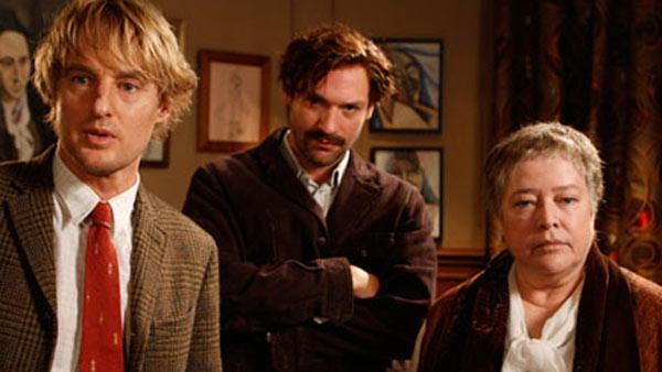 Owen Wilson, Corey Stoll (as writer Ernest Hemingway) and Kathy Bates appear in a scene from the 2011 movie 'Midnight in Paris.'