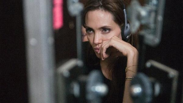 Angelina Jolie appears behind the camera as she makes her directorial debut with