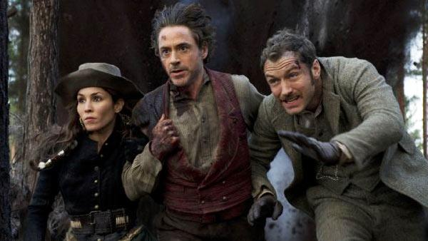 Jude Law, Robert Downey Jr. and Noomi Rapace appear in a still from Sherlock Holmes: A Game of Shadows. - Provided courtesy of Warner Bros. Entertainment / Daniel Smith