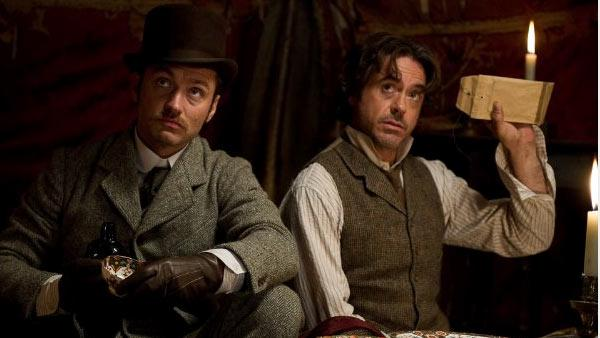 Jude Law and Robert Downey Jr. appear in a still from Sherlock Holmes: A Game of Shadows. - Provided courtesy of Warner Bros. Entertainment / Daniel Smith